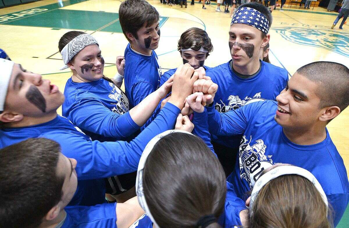 Hour Photo/Alex von Kleydorff Team D4 Bound gets pumped up for Dodgeball during Norwalk High School's sixth annual Charity Dodgeball Tournament to benefit local charities