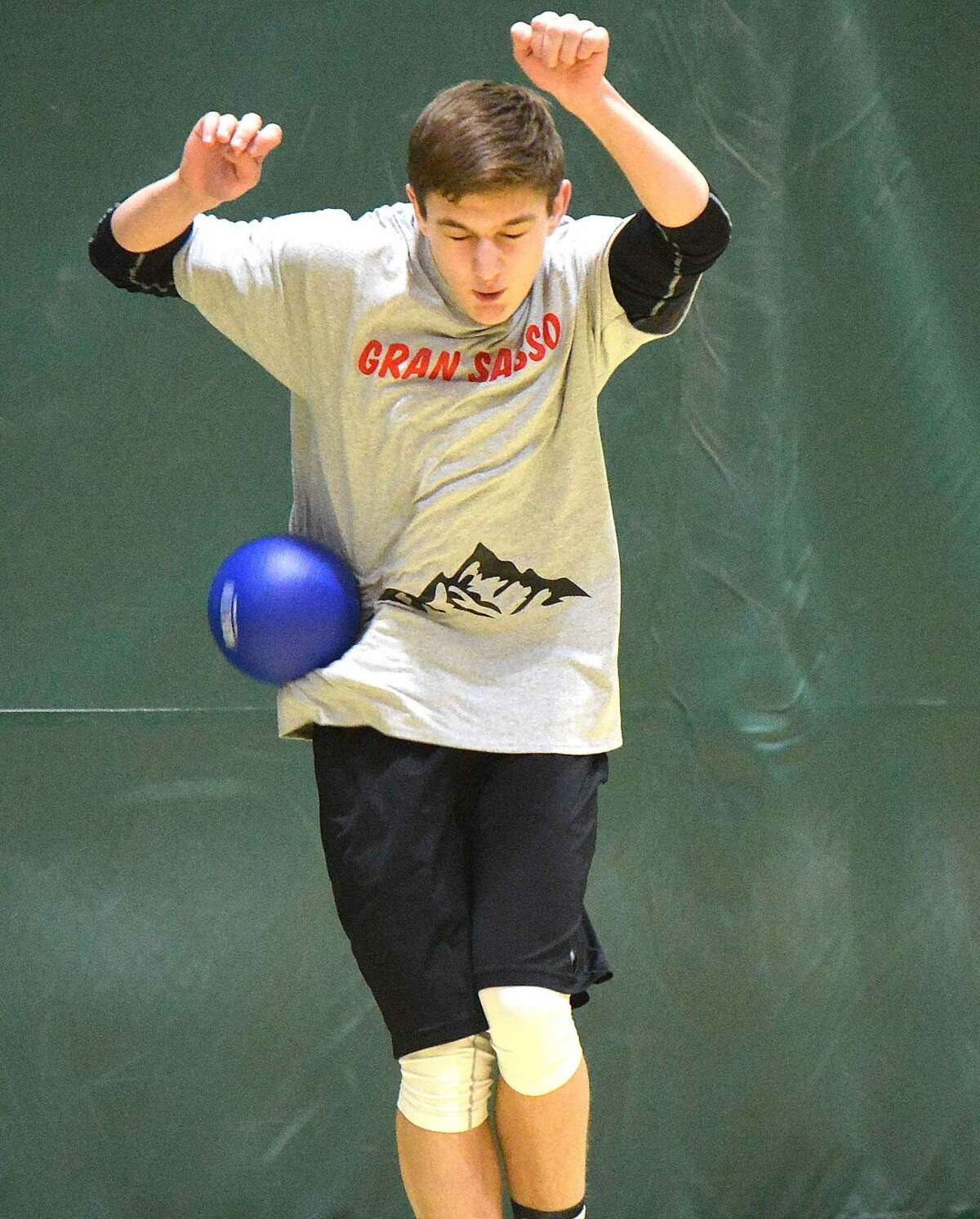Hour Photo/Alex von Kleydorff Last man standing until now, Alex Morrissey takes one for the team during Norwalk High School's sixth annual Charity Dodgeball Tournament to benefit local charities