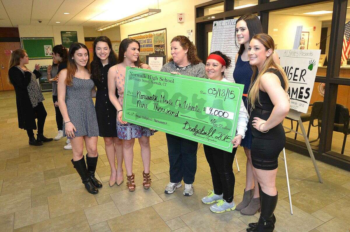 Hour Photo/Alex von Kleydorff The big check goes to charities during Norwalk High School's sixth annual Charity Dodgeball Tournament to benefit local charities