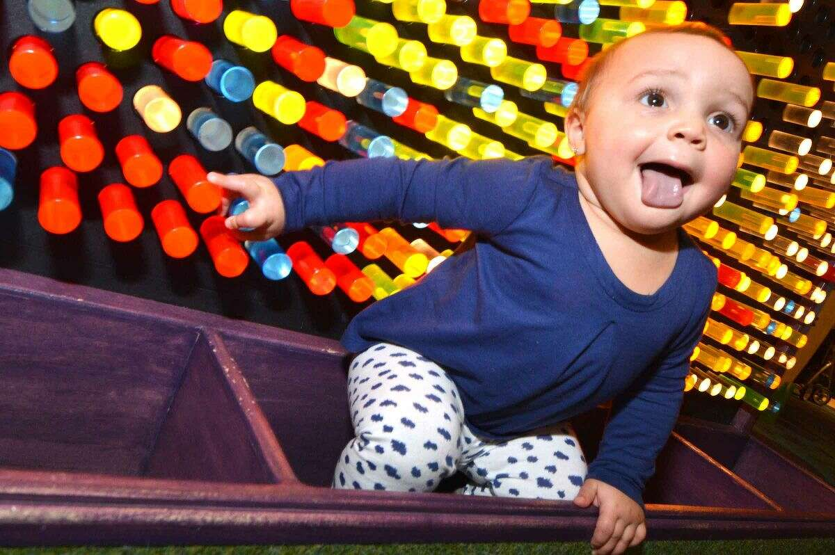 Hour Photo/Alex von Kleydorff 1 yr old Hudsin Gonzalez climbs up on the giant Light Bright set during the 15 yr anniversary at Stepping Stones Museum for Children