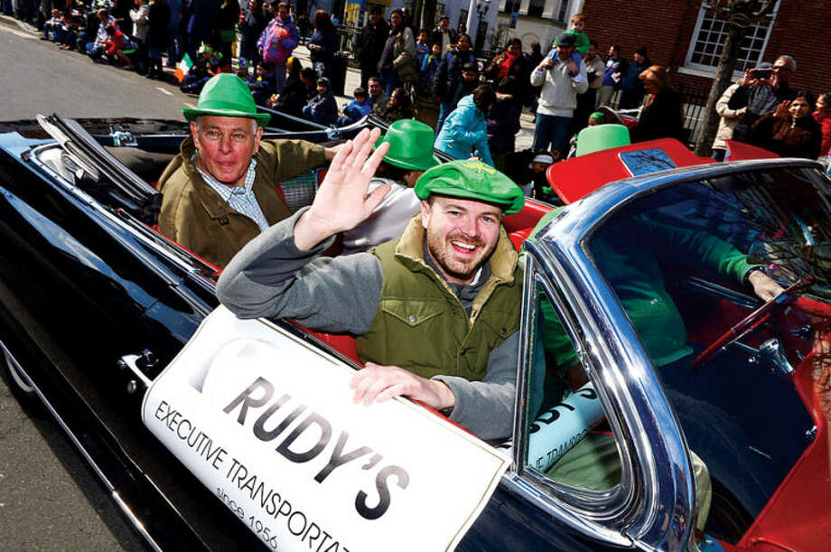 Hour photo / Erik Trautmann Rudy's Limousine participates in The Stamford St. Patrick's Day Parade as it follows last year's parade route proceeding North on Atlantic Street and continuing onto Bedford Street Saturday.