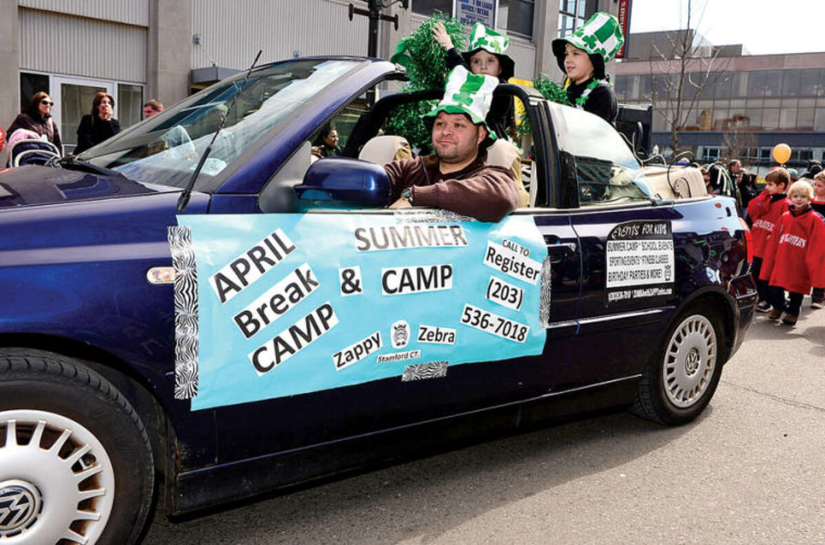 Hour photo / Erik Trautmann Zappy Zebra Summer Camps participate in The Stamford St. Patrick's Day Parade as it follows last year's parade route proceeding North on Atlantic Street and continuing onto Bedford Street Saturday.