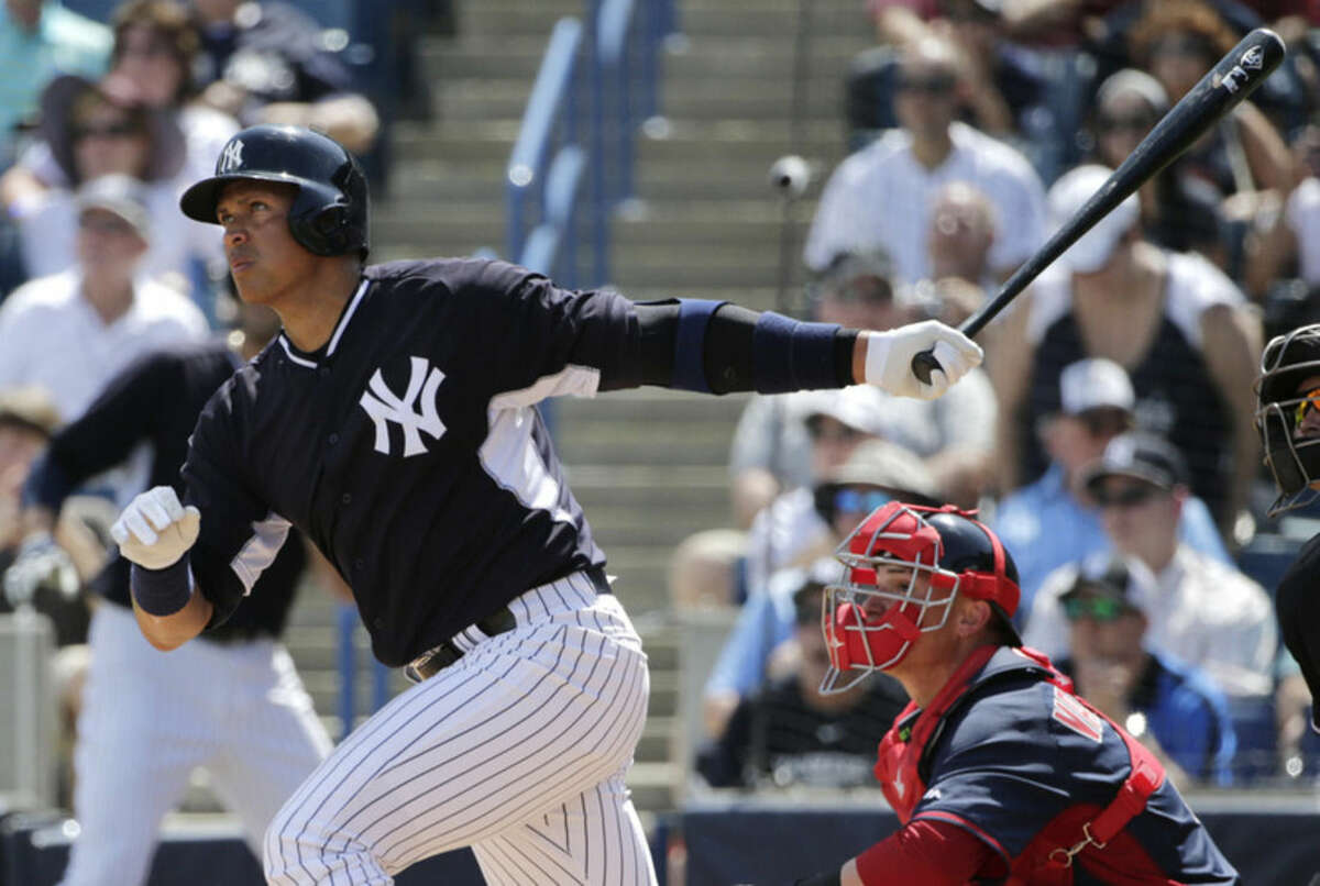 New York Yankees Alex Rodriguez watches his fourth-inning, solo home run off Boston Red Sox starting pitcher Brandon Workman during a spring baseball game in Tampa, Fla., Wednesday, March 11, 2015. It was Rodriguez's first home run of spring training. (AP Photo/Kathy Willens)