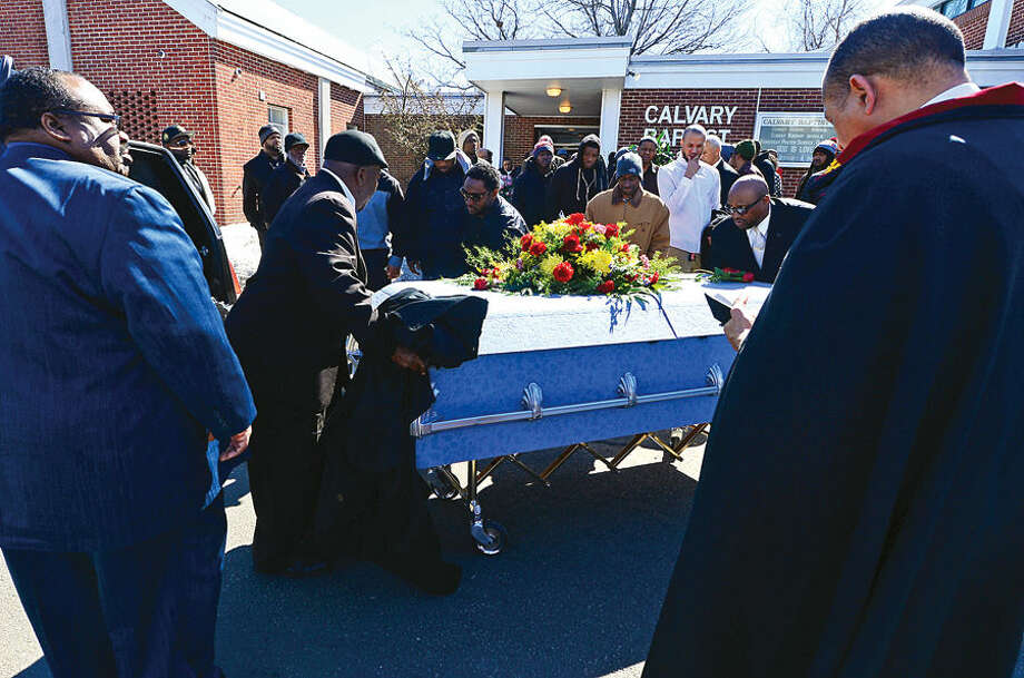Hour photo / Erik Trautmann Pallbearers and the Reverend Jeffery Ingraham lead the processional following the funeral service for local resident and Brien McMahon High School coach Maurice Tomlin at Calvary Baptist Church Thursday afternoon.