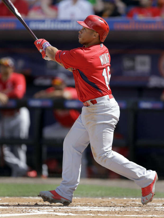 St. Louis Cardinals' Kolten Wong watches his ground-rule double to score Oscar Taveras during the second inning of an exhibition spring training baseball game against the New York Mets Friday, March 7, 2014, in Port St. Lucie, Fla. (AP Photo/Jeff Roberson)