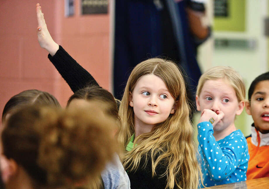 Hour photo / Erik Trautmann US Congressman Jim Himes visits a Marvin Elementary School third grade class Thursday to talk about the federal government in response to a letter written by one of the students, Zoe Monschein, center.