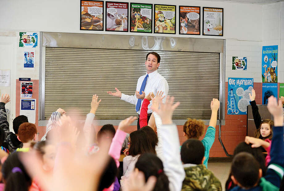 Hour photo / Erik Trautmann US Congressman Jim Himes visits a Marvin Elementary School third grade class Thursday to talk about the federal government in response to a letter written by one of the students.