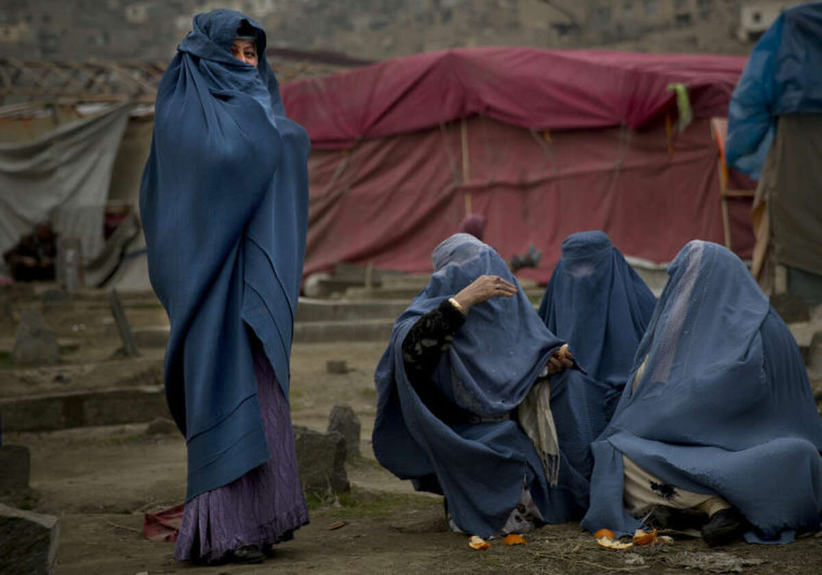 In this Friday, March 7, 2014 photo, Afghan women gather at a cemetery in the center of Kabul, Afghanistan. A gender and development specialist and human rights activist, Afghan Wazhma Frogh says her experience characterizes the women?'s rights movement in her country- after 12 years, billions of dollars and countless words emanating from the West commiserating with Afghan women, the successes are fragile, the changes superficial and vulnerable. (AP Photo/Anja Niedringhaus)