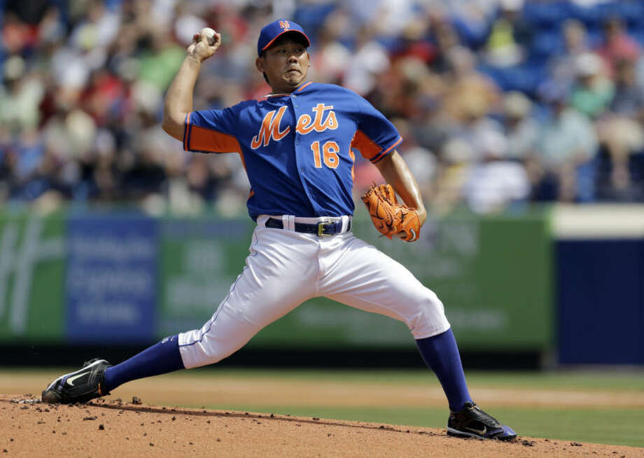New York Mets starting pitcher Daisuke Matsuzaka throws during the first inning of an exhibition spring training baseball game against the St. Louis Cardinals Friday, March 7, 2014, in Port St. Lucie, Fla. (AP Photo/Jeff Roberson)