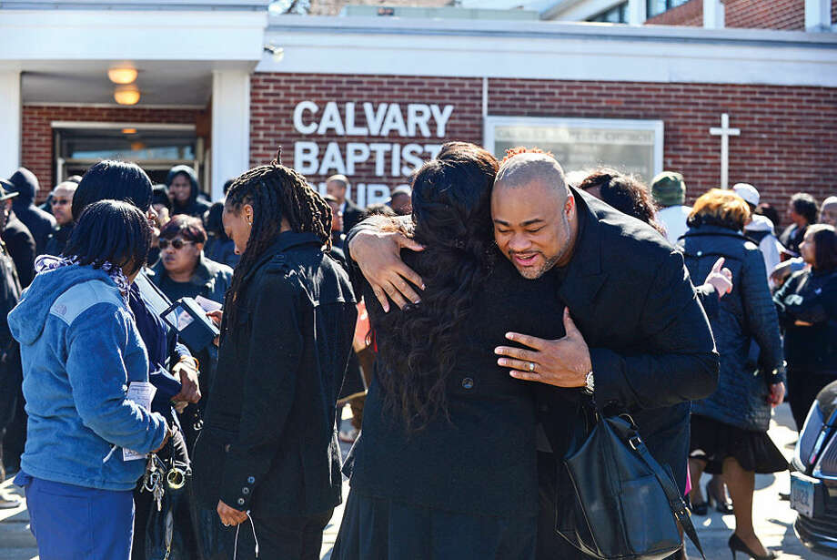Hour photo / Erik Trautmann Funeral goers share condolences following the funeral service for local resident and Brien McMahon High School coach Maurice Tomlin at Calvary Baptist Church Thursday afternoon.