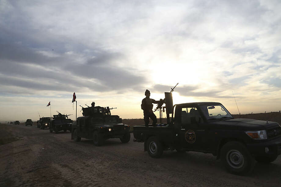 Iraqi security forces patrol in Tikrit, 80 miles (130 kilometers) north of Baghdad, Iraq, Thursday, March 12, 2015. Rockets and mortars echoed across Saddam Hussein's hometown of Tikrit on Thursday as Iraqi security forces clashed with Islamic State militants a day after sweeping into the Sunni city north of Baghdad. (AP Photo/Khalid Mohammed)
