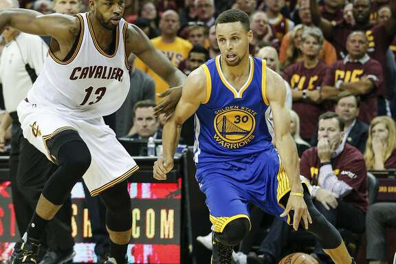 Golden State Warriors' Stephen Curry drives past Cleveland Cavaliers' Tristan Thompson in the second quarter during Game 4 of the NBA Finals at The Quicken Loans Arena on Friday, June 10, 2016 in Cleveland, Ohio.
