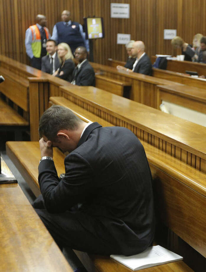 Oscar Pistorius, in the dock on the second day of his trial at the high court in Pretoria, South Africa, Tuesday, March 4, 2014. Pistorius is charged with murder for the shooting death of his girlfriend, Reeva Steenkamp, on Valentines Day in 2013. (AP Photo/Kim Ludbrook, Pool)