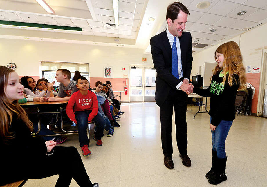 Hour photo / Erik Trautmann US Congressman Jim Himes visits a Marvin Elementary School third grade class Thursday to talk about the federal government in response to a letter written by one of the students, Zoe Monschein.