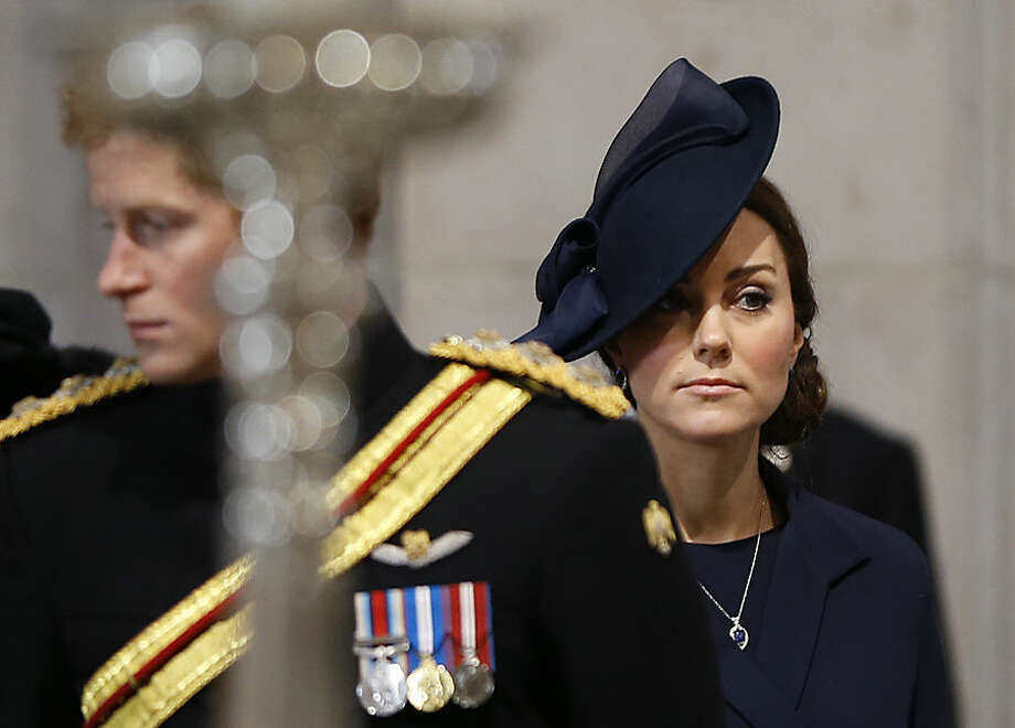 Britain's Kate, the Duchess of Cambridge stands near Prince Harry as they arrive to attend the Service of Commemoration - Afghanistan, at St Paul's Cathedral in London, Friday, March 13, 2015. The Queen and Britain's prime minister are joining veterans in a service to commemorate the end of Britain's combat operations in Afghanistan. Prince William, his pregnant wife Kate, and Prince Harry — who served two tours during the conflict — will also attend the ceremony to remember the war dead. Almost 150,000 Britons served in the conflict, and 453 died. (AP Photo/Kirsty Wigglesworth, pool)