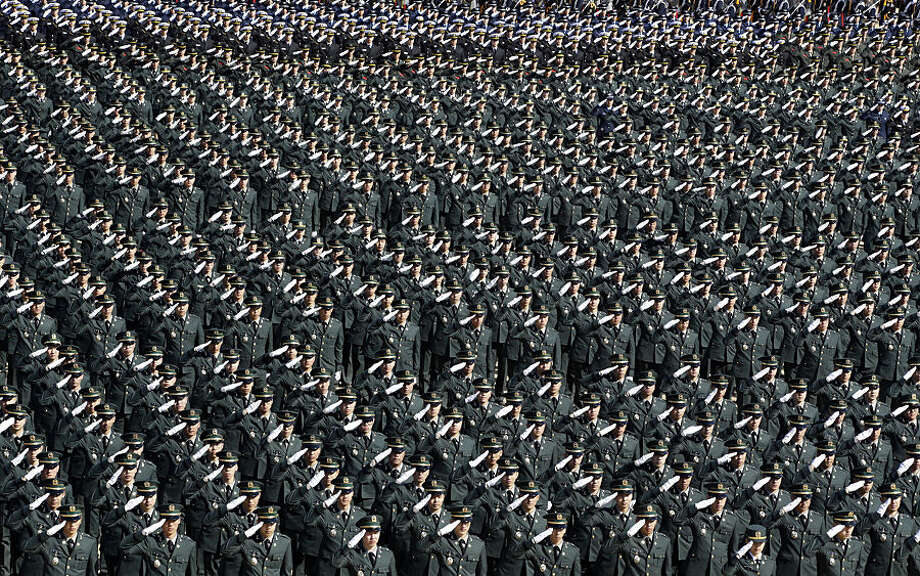 New South Korean military officers salute during the joint commission ceremony of over 6,000 new military officers of the army, navy, air force and marines at the military headquarters in Gyeryong, south of Seoul, South Korea, Thursday, March 12, 2015. (AP Photo/Lee Jin-man)
