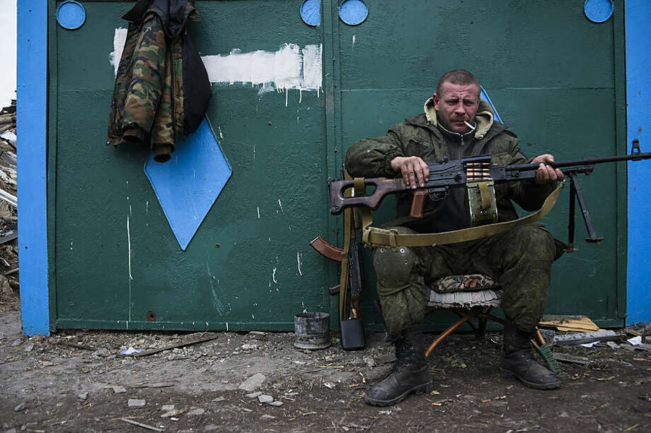 A pro-Russian rebel rests at the frontline in a illage not far from Luhasnk, eastern Ukraine, Thursday, March 12, 2015. Pro-Russian rebels in Ukraine's Luhansk region are taking advantage of the ongoing cease-fire, enjoying a lull in hostilities but fighters on the front line speak of sporadic fighting with Ukrainian government troops. (AP Photo/Mstyslav Chernov)