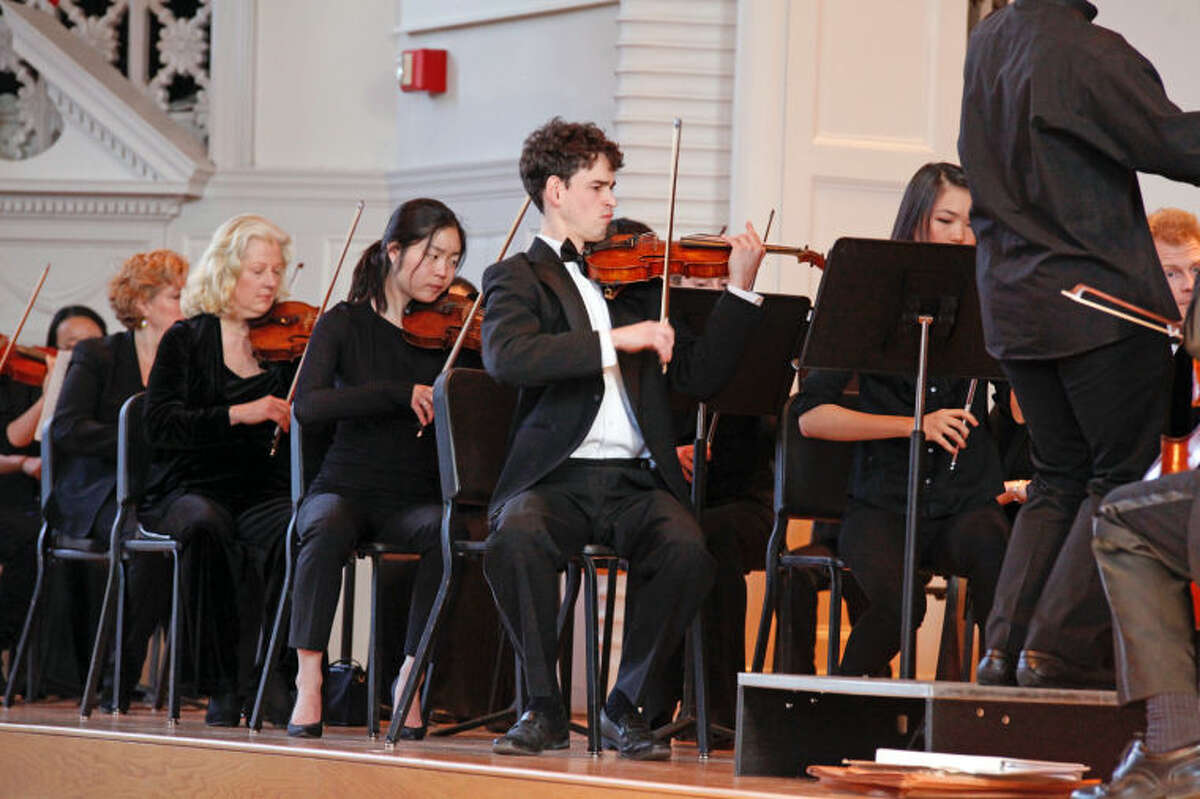 """Overture to """"Barber of Seville"""" is played by Side-by-Side and the Norwalk Youth Symphony Principal Orchestra at Norwalk City Hall Sunday afternoon. Hour Photo / Danielle Calloway"""