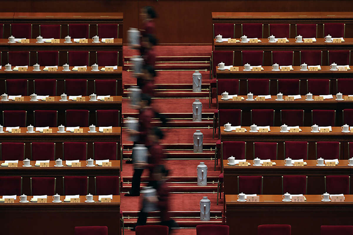 Hostesses prepare tea for members of the National Committee of the Chinese People's Political Consultative Conference (CPPCC) ahead of the closing ceremony of the CPPCC at the Great Hall of the People in Beijing Friday, March 13, 2015. (AP Photo/Andy Wong)