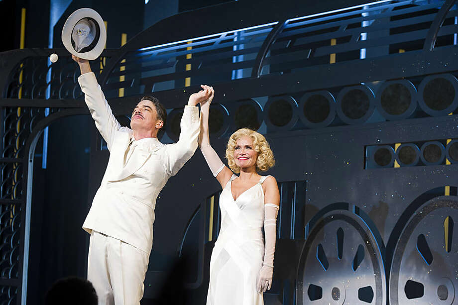 """Peter Gallagher, left, and Kristin Chenoweth appear at the curtain call for the opening night performance of """"On the Twentieth Century"""" on Thursday, March 12, 2015 in New York. (Photo by Charles Sykes/Invision/AP)"""