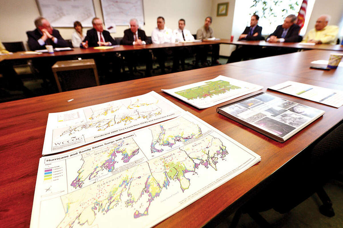 Hour photo / Erik Trautmann US Congressman Jim Himes holds a roundtable discussion regarding a forthcoming flood mitigation study Friday in the office of Western Connecticut Council of Governments at the Stamford Government Center.