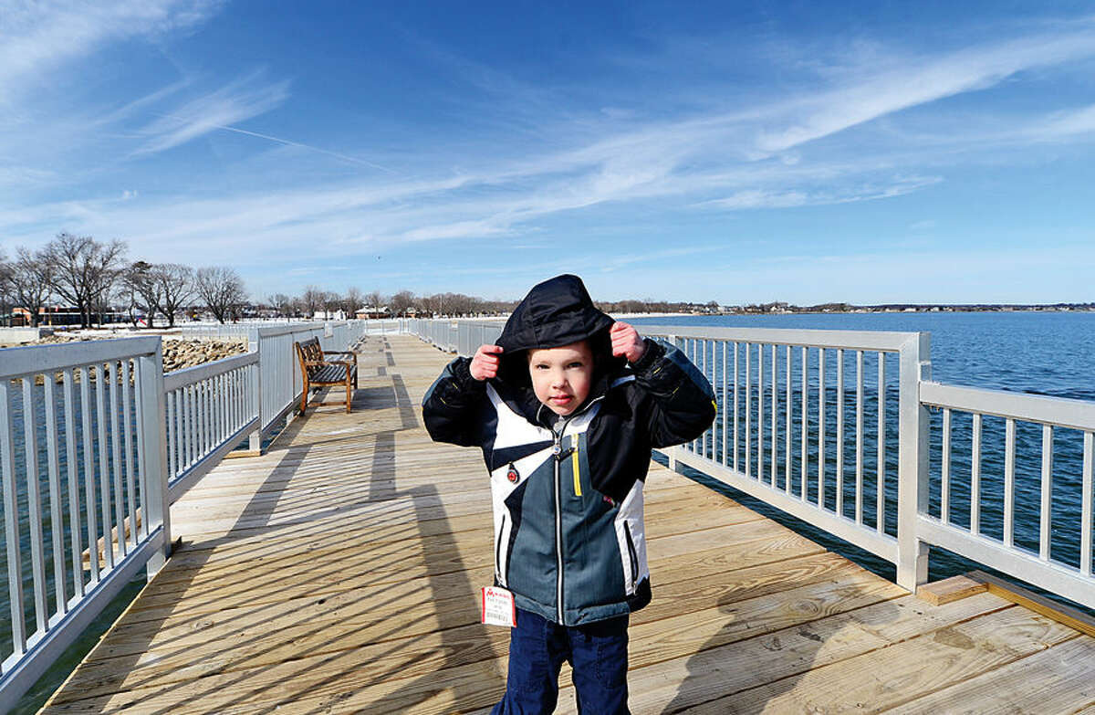 Hour photo / Erik Trautmann Will Steese, 5, takes advantage of the mild weather by walking onto the pier at Calf Pature Beach Friday afternoon.