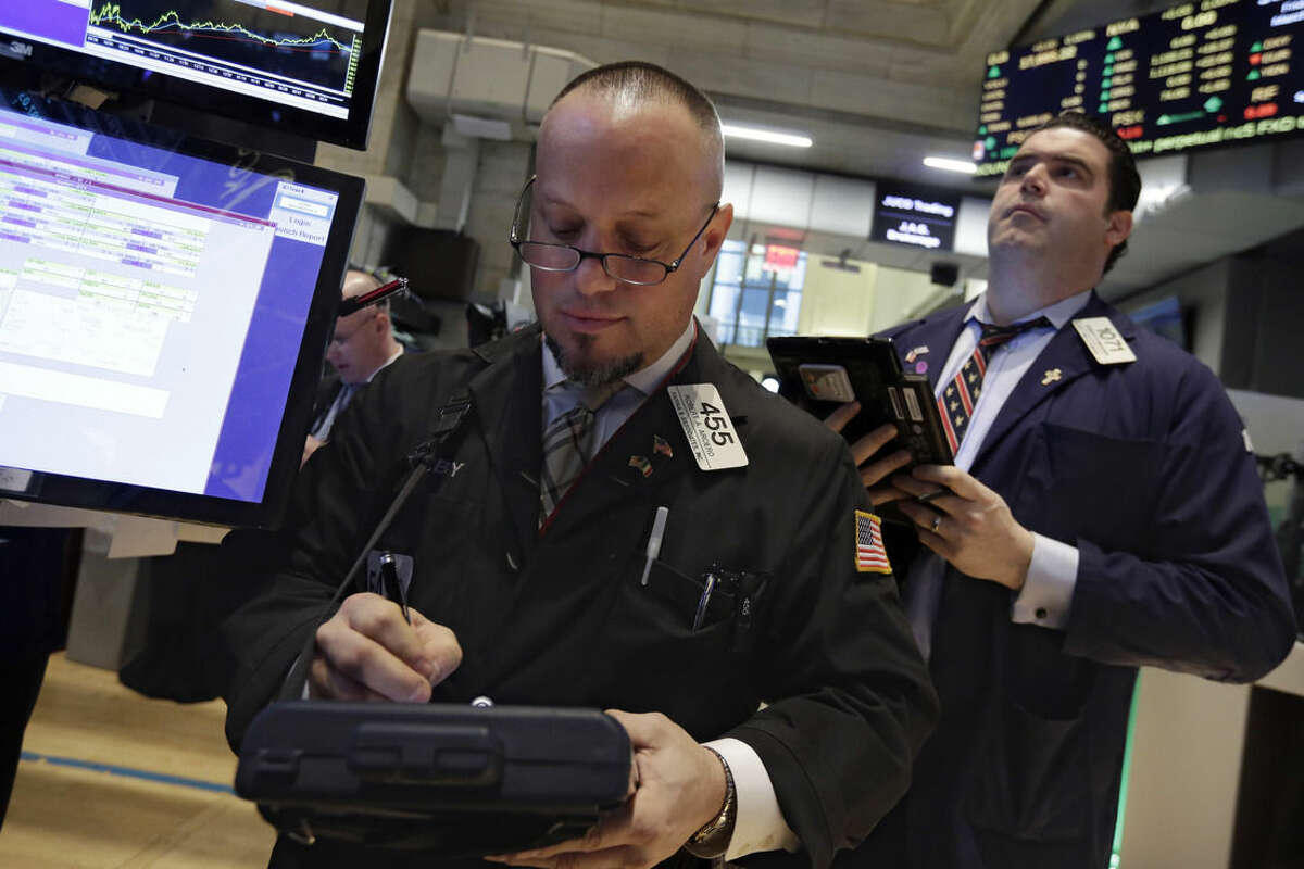 Trader Robert Arciero, left, works on the floor of the New York Stock Exchange, Friday, March 13, 2015. U.S. stocks are opening slightly lower a day after the market notched its best performance in five weeks. (AP Photo/Richard Drew)