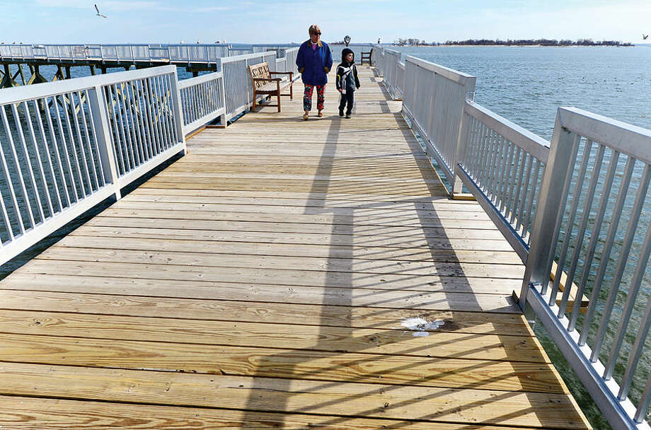 Hour photo / Erik Trautmann Local residents including Ellen Mulhearn and her gradson Will Steese, 5, take advantage of the mild weather by walking onto the pier at Calf Pature Beach Friday afternoon.