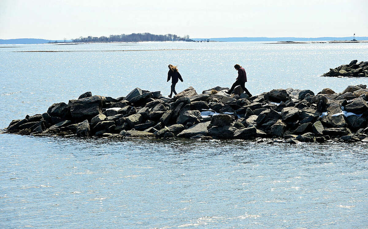 Hour photo / Erik Trautmann Local residents take advantage of the mild weather at Calf Pature Beach Friday afternoon.
