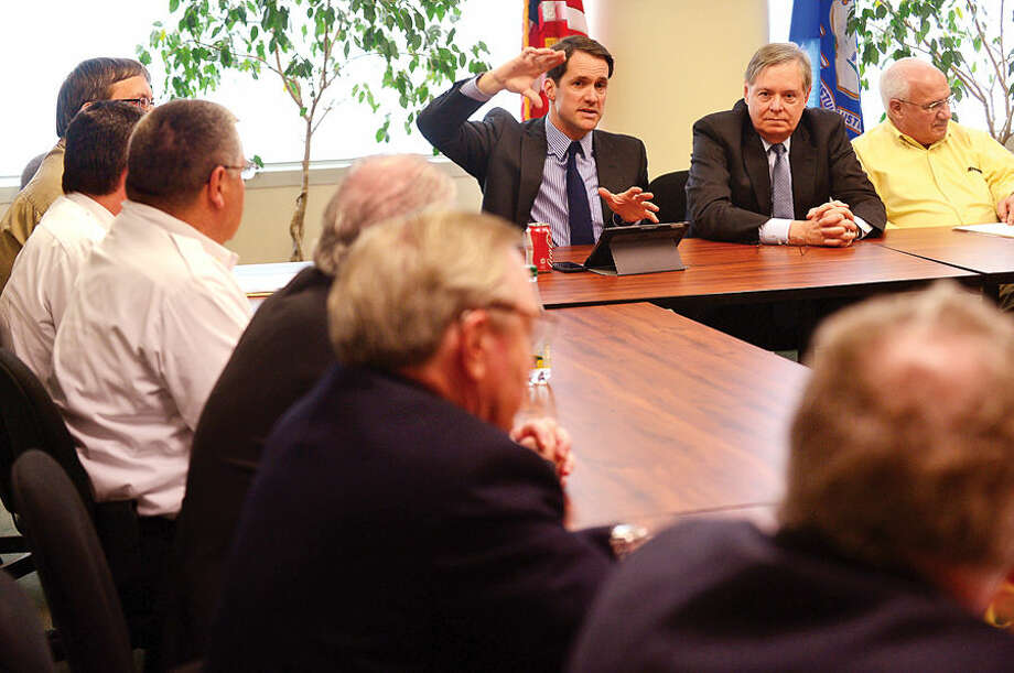 Hour photo / Erik Trautmann US Congressman Jim Himes holds a roundtable discussion regarding a forthcoming flood mitigation study Friday in the office of Western Connecticut Council of Governments at the Stamford Government Center with Stamford mayor David Martin.