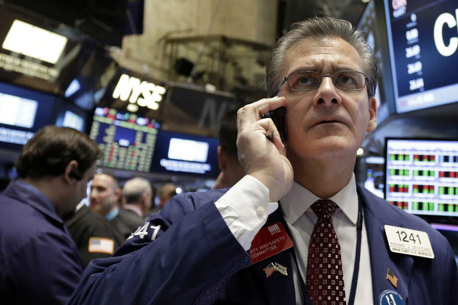 Trader Richard Deviccario works on the floor of the New York Stock Exchange, Friday, March 13, 2015. U.S. stocks are opening slightly lower a day after the market notched its best performance in five weeks. (AP Photo/Richard Drew)
