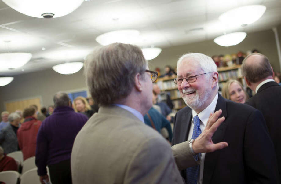 The Rev. Thomas Ogletree smiles during a conversation following a news conference announcing that a case against him for breaking church law by officiating his son's same-sex marriage had been dropped, Monday, March 10, 2014, in White Plains, N.Y. Bishop Martin McLee, who announced the decision, called on church officials to stop prosecuting other pastors for marrying same-sex couples. McLee, who leads the church's New York district said he would cease church trials over the issue in his district and would organize a broad discussion about the church's internal divisions over gay relationships. (AP Photo/John Minchillo)