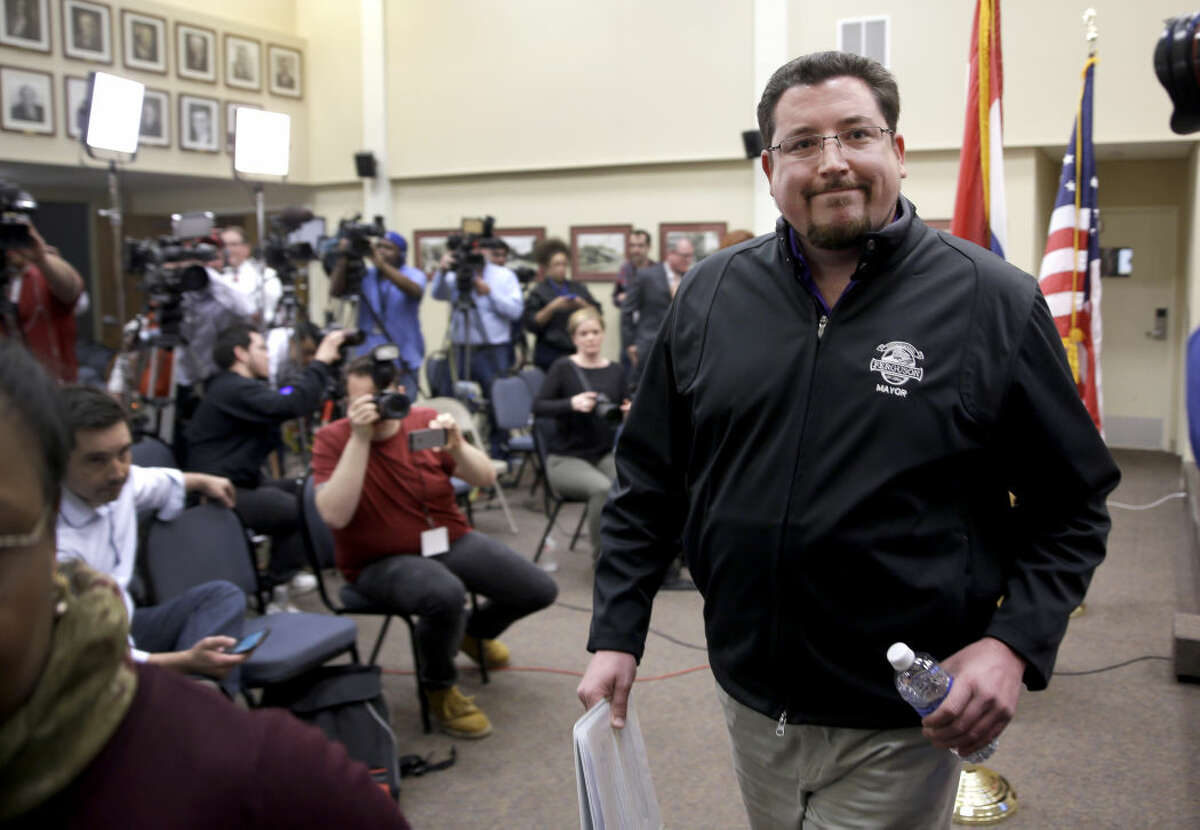 Ferguson Mayor James Knowles III leaves a news conference after announcing the resignation of police chief Thomas Jackson, Wednesday, March 11, 2015, in Ferguson, Mo. Jackson's resignation came a week after a scathing U.S. Justice Department report found the St. Louis suburb to have a profit-driven court system and widespread racial bias in the police force. (AP Photo/Jeff Roberson)