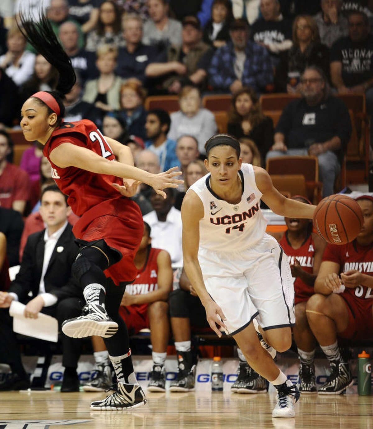 Connecticut's Bria Hartley, right, drives past Louisville's Bria Smith, left, during the first half of an NCAA college basketball game in the finals of the American Athletic Conference women's basketball tournament, Monday, March 10, 2014, in Uncasville, Conn. (AP Photo/Jessica Hill)