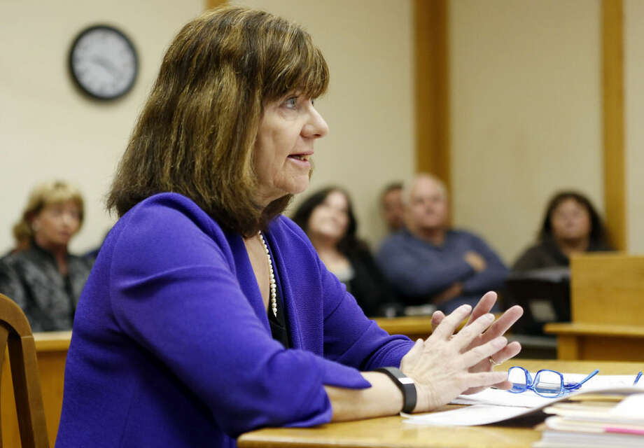 "Cathy Green speaks on behalf of her client William ""Billy"" Flynn, Thursday, March 12, 2015, during Flynn's parole hearing at the state prison in Concord, N.H. The parole board granted Flynn parole nearly 25 years after he shot and killed Gregg Smart, in what prosecutors said was Pamela Smart's plot to murder her husband. (AP Photo/Jim Cole)"