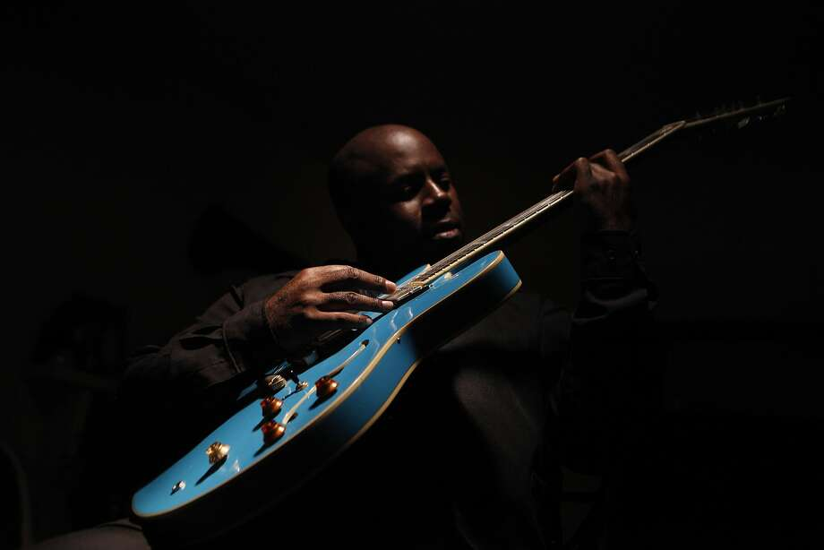 Levi Seacer of Richmond plays his guitar Blue Angel on Friday, June 10, 2016 in his home in Richmond, California. Seacer spent six years as the leader of Prince's New Power Generation (1988-1994). Photo: Michael Noble Jr., The Chronicle