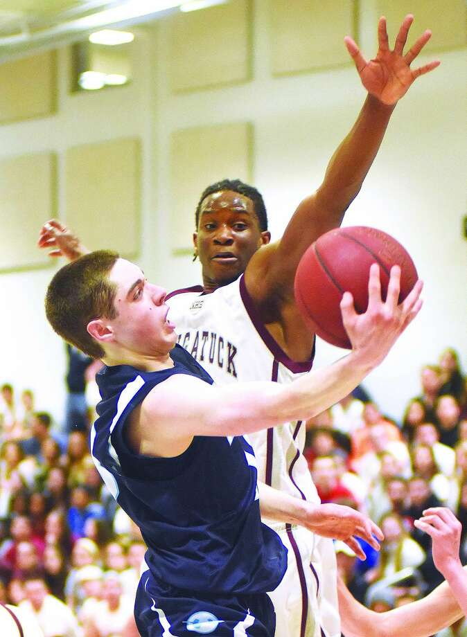 Wilton's Matt Shifrin, front, goes up for a shot against the defense of Naugatuck's Fejiro Onakpoma during the second half of Thursday's CIAC Class L second round state tournament boys basketball game. (Hour photo/John Nash)