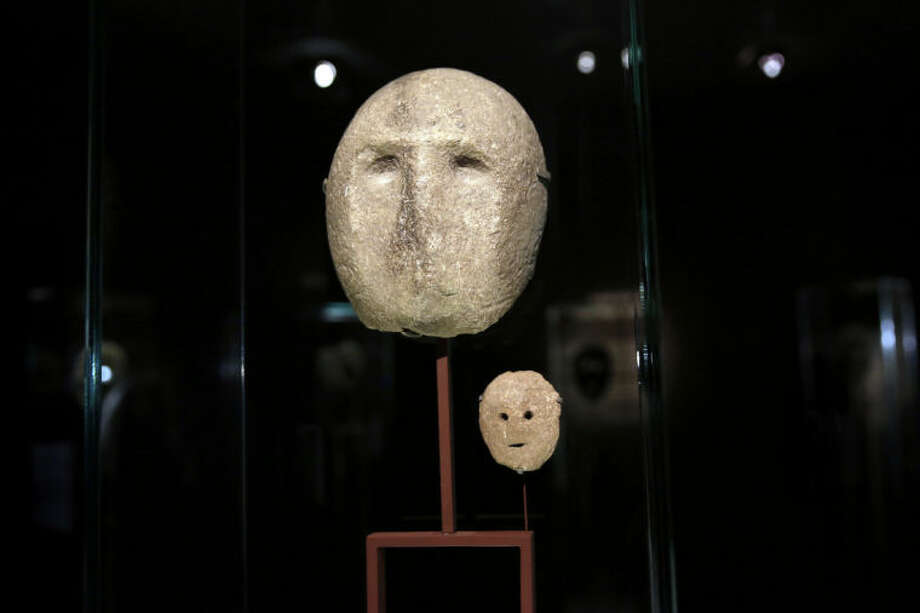 "In this Monday, March 10, 2014 photo, 9,000 year-old masks are on display at the Israel Museum in Jerusalem. The exhibition called ""Face To Face"" shows eleven stone masks, said to have been discovered in the Judean desert and hills near Jerusalem, which date back 9,000 years and offer a rare glimpse at some of civilization's first communal rituals. (AP Photo/Tsafrir Abayov)"
