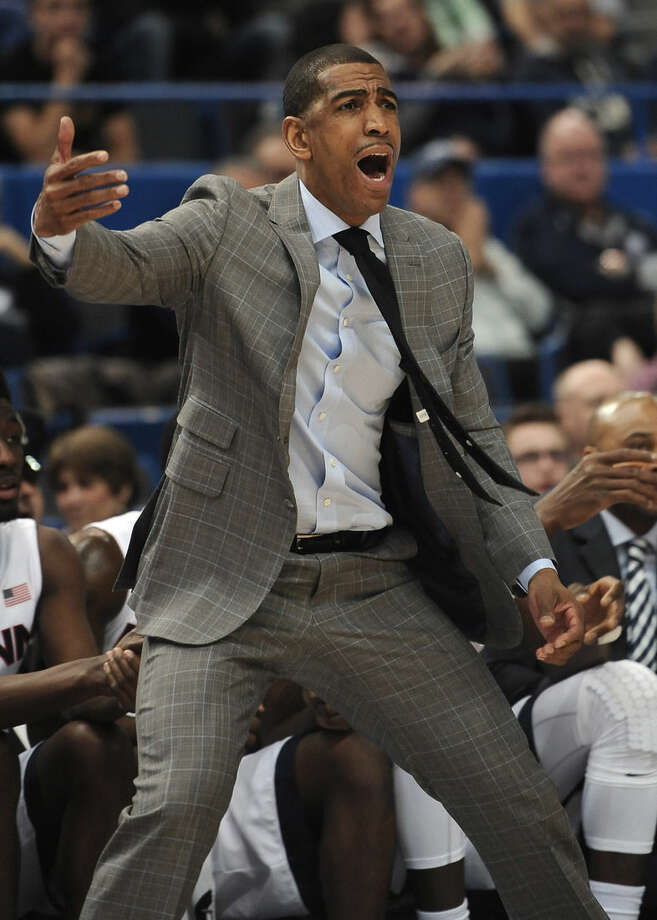 Connecticut head coach Kevin Ollie reacts during the first half of an NCAA college basketball game against South Florida in the first round of the American Athletic Conference tournament, Thursday, March 12, 2015, in Hartford, Conn. (AP Photo/Jessica Hill)