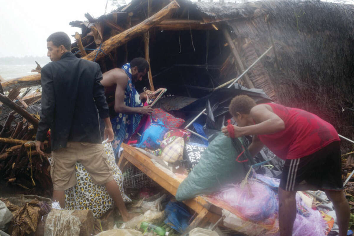 AP photo/UNICEF Pacific, Humans of Vanuatu In this image provided by UNICEF Pacific people scour through debris damaged and flung around in Port Vila, Vanuatu, Saturday in the aftermath of Cyclone Pam.