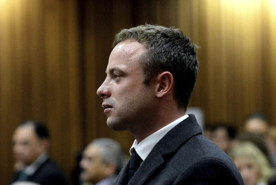 In this photo taken Monday March 10, 2014, Oscar Pistorius cries as he listens to cross questioning about the events surrounding the shooting death of his girlfriend Reeva Steenkamp, in court during his trial in Pretoria, South Africa. Pistorius is charged with the shooting death of Steenkamp, on Valentines Day in 2013. (AP Photo/Bongiwe Mchunu, Pool)