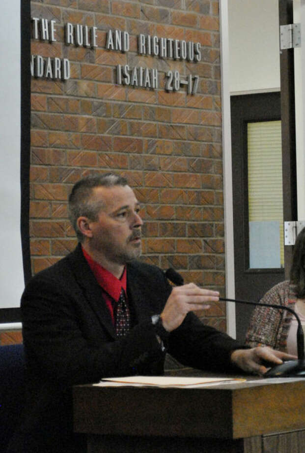 Det. Jeremi Thompson, with the Franklin County Sheriff's Office, testifies during a hearing in Kyle Flack's capital murder trial in Franklin County District Court Tuesday, March 11, 2014, in Ottawa, Kan. Flack, 28, is charged with capital murder and other charges in the slaying of of Andrew Stout, Steven White and Kaylie Bailey, including Bailey's 18-month-old daughter, at a farm in rural eastern Kansas last spring. (AP Photo/The Ottawa Herald, Abby Eckel, Pool)