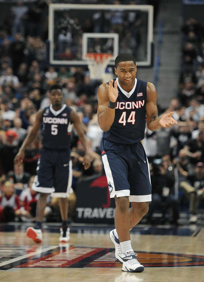 Connecticut's Rodney Purvis applauds during the second half of an NCAA college basketball game against Cincinnati in the quarterfinals of the American Athletic Conference tournament, Friday, March 13, 2015, in Hartford, Conn. (AP Photo/Jessica Hill)
