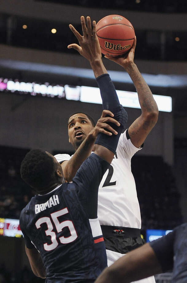 Cincinnati's Octavius Ellis shoots as Connecticut's Amida Brimah defends during the first half of an NCAA college basketball game in the quarterfinals of the American Athletic Conference tournament, Friday, March 13, 2015, in Hartford, Conn. (AP Photo/Jessica Hill)