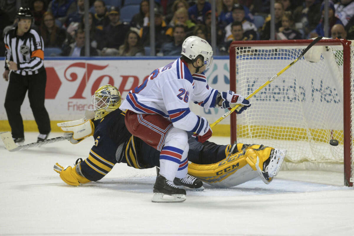 New York Rangers right winger Martin St. Louis (26) misses the net after Buffalo Sabres goaltender Anders Lindback, of Sweden, makes a pad save during the second period of an NHL hockey game Saturday, March 14, 2015, in Buffalo, N.Y. (AP Photo/Gary Wiepert)