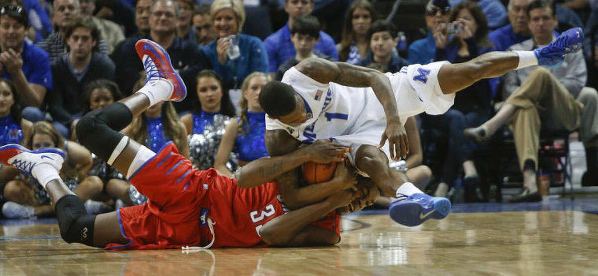 Memphis guard Joe Jackson (1) scrambles for a loose ball against SMU center Yanick Moreira (35) in the second half of an NCAA college basketball game Saturday, March 8, 2014, in Memphis, Tenn. Memphis won 67-58. (AP Photo/Lance Murphey)
