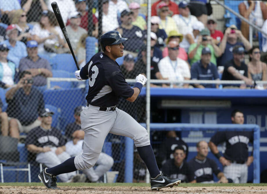 New York Yankees' Alex Rodriguez hits a single in the fourth inning of a spring training baseball game against the Toronto Blue Jays in Dunedin, Fla., Saturday, March 14, 2015. (AP Photo/Kathy Willens)
