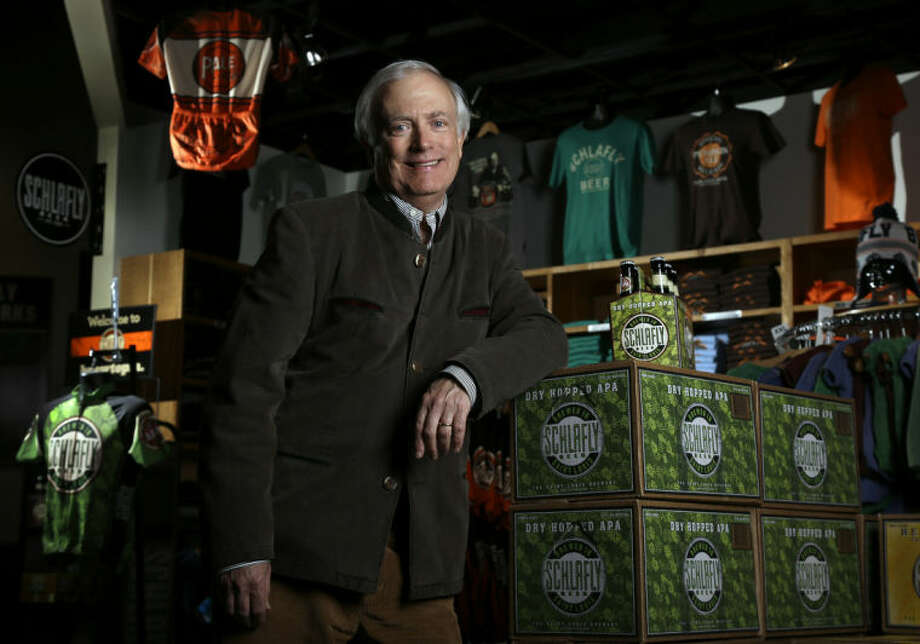 Tom Schlafly, co-founder of the brewery which produces the Schlafly brand of beers, poses for a photo inside the gift shop at Schlafly Bottleworks on Wednesday, March 12, 2014, in Maplewood, Mo. Schlafly has been in a trademark dispute with his aunt, conservative activist Phyllis Schlafly, over whether Schlafly is primarily a last name or a commercial brand that deserves legal protection. (AP Photo/Jeff Roberson)