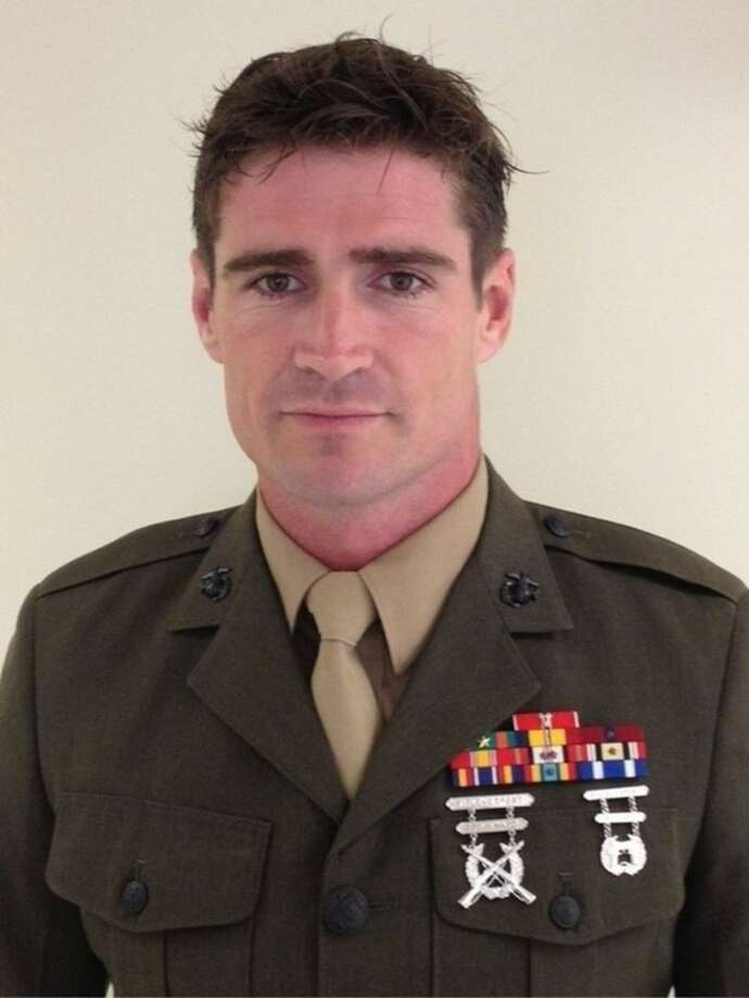 This image provided by the U.S. Marine Corps shows an undated photo of Staff Sgt. Liam Flynn, 33. Friday, March 13, 2015, military officials released the names of the Marines killed. All were from the 2nd Special Operations Battalion of the Marine Corps Special Operations Command, or MARSOC, at Camp Lejeune. Staff Sgt. Flynn was one of the seven Marines killed when the Black Hawk helicopter crashed in dense fog during a training mission in Florida. (AP Photo/US Marine Corps)