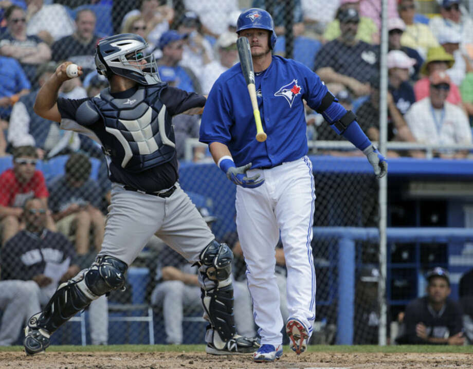 New York Yankees catcher Eddy Rodriguez, right, returns the ball to the pitcher as Toronto Blue Jays Josh Donaldson reacts, tossing his bat after he struck out looking in the fourth inning of a spring baseball game against the New York Yankees in Dunedin,Fla., Saturday, March 14, 2015. The Blue Jays defeated the Yankees 1-0. (AP Photo/Kathy Willens)